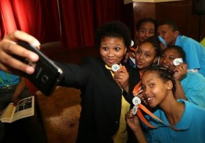 Mac-Kaylen Johnson(holding the phone), (Back) Amelia Vester, Bradley Gravers, (Middle) Tiffany Swarts, Gladys Julies and (Front) Chante Arnold showing of their meddles while taking a selfie during the BIBOVALLA Youth Summit Feedback Session Programme at Goodwood Civic Centre on October 13, 2016 in Cape Town, South Africa. (Photo by Carl Fourie)