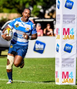 RUSTENBURG, SOUTH AFRICA - APRIL 06:  McDonald Duma of Rustenburg breaks the Rhino defence and score a try defence during the Gold Cup, Semi-Final match between Newrak Rustenburg Impala and Northern Platinum Rhinos at Impala Rugby Club on April 06, 2019 in Rustenburg, South Africa. (Photo by Sydney Seshibedi/Gallo Images)