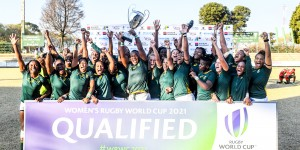 BRAKPAN, SOUTH AFRICA - AUGUST 17:  Babalwa Latsha of South Africa lifts the trophy with the team as they qualify during the Women's World Cup qualifier match between South Africa and Kenya at Bosman Stadium on August 17, 2019 in Brakpan, South Africa. (Photo by Sydney Seshibedi/Gallo Images)